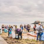 130 people paddleboard from Mumbles to Aberavon for charity